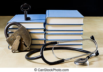 Heap of books reading on a wooden table. Beside lies and stethoscope. Black background.