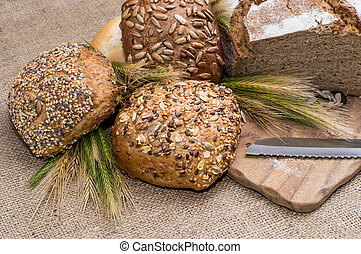 Heap of bread with knife