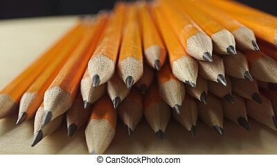 Heap of bright pencils, close up dolly shot clip