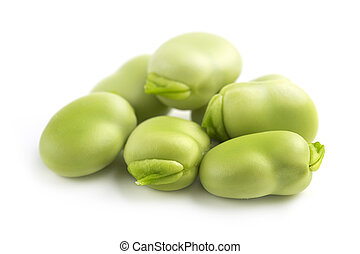 heap of broad beans - close up of fresh broad beans on white...
