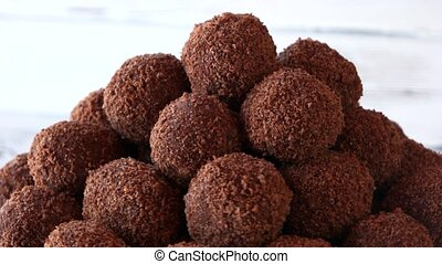 Heap of brown ball-shaped sweets. Chocolate gingerbread...