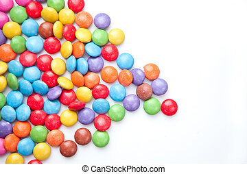 Heap of candies multi coloured against a white background