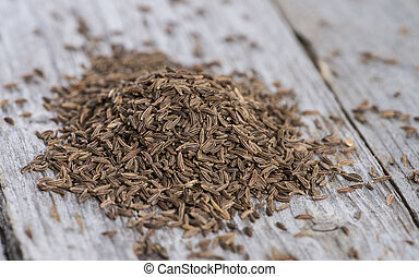 Heap of Caraway on vintage wooden background (macro shot)
