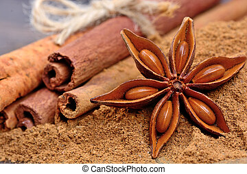 Heap of cinnamon sticks and anise star on table
