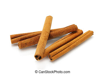 Heap of cinnamon sticks on white background