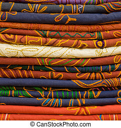 Heap of cloth fabrics at a local market in India.