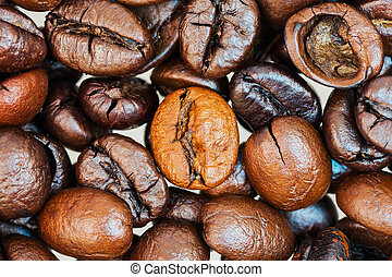 Heap of coffee beans on the table