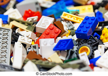 Macro view of heap of color plastic toy bricks. Selective focus effect