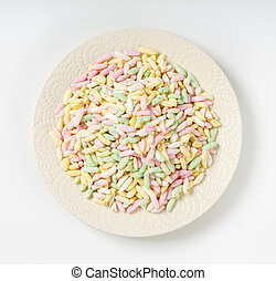 heap of colored puffed rice on plate