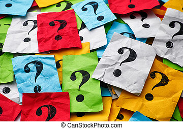 Heap of colorful paper notes with question marks