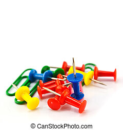 heap of colorful push pin and paperclip isolated on white backgr