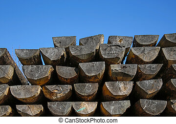 heap of construction wooden logs for house building