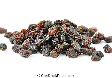Heap of dark raisins on white background