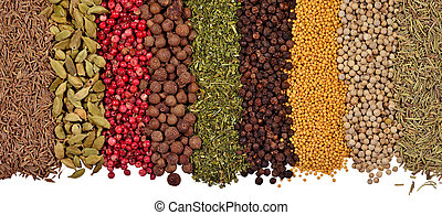 Heap of different dry spices on a white