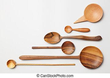 Heap of different kitchen wooden utensils cutlery