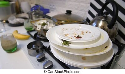 Heap of dirty dishes on the table - Huge heap of dirty...