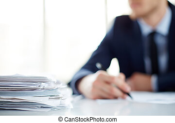 Heap of documents - Stack of documents at workplace and male...