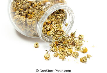 Heap of dried chamomile in glass jar - Closeup of dried...