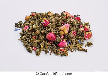 Heap of dried green tea leaves.
