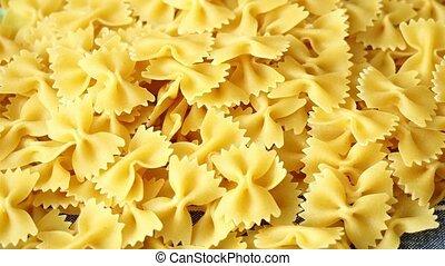 Heap of farfalle pasta.Top view