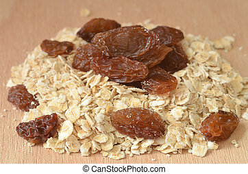 Heap of fine oat flakes and raisins