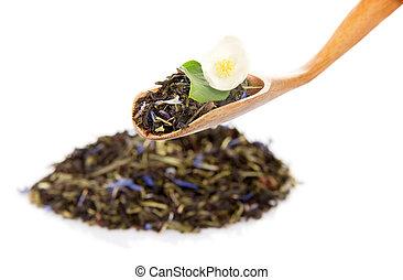 Heap of fragrant tea leaves with cornflower petals