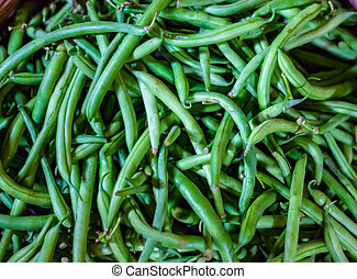 heap of france green beans in retail vegetable super market for sale