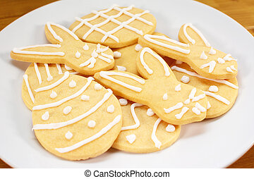 Heap of frosted Easter biscuits on a plate