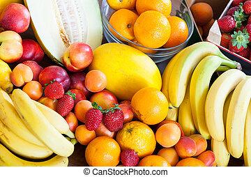 Heap of fruits at table i