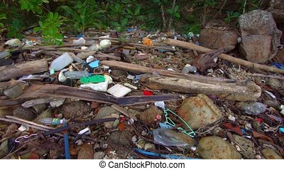 Heap of garbage on the wild beach of Phuket island, Thailand