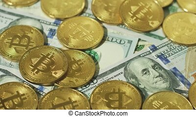 Heap of gold bitcoins on bills - Arrangement of brightly...