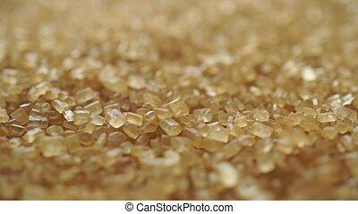 Heap of granulated brown sugar macro dolly shot, shallow...