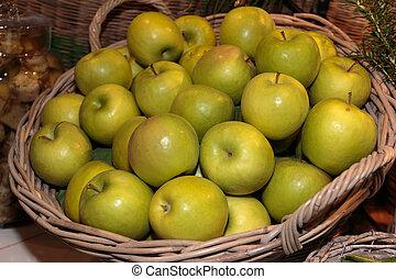 Heap of Green Apples in Wicker Box