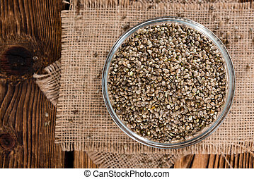 Heap of Hemp Seeds on wooden background (cloese-up shot)