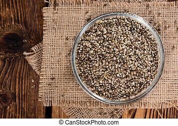 Heap of Hemp Seeds on wooden background (cloese-up shot)