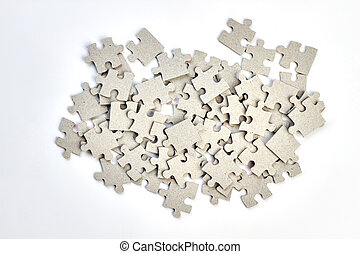 Heap of jigsaw puzzles on white background.