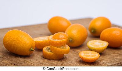 heap of kumquat on a wooden table