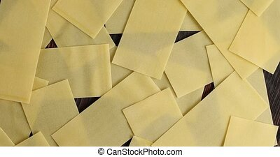 Heap of lasagna sheets on table - From above of chaotic...