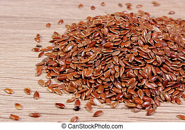 Heap of linseed on wooden background