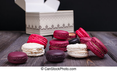 heap of macaroons on a wooden table