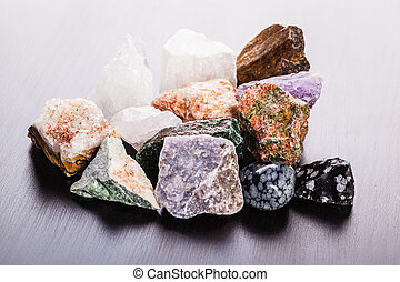 heap of minerals on wood - close up shot of a heap of...