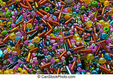 Heap of multicolor glass beads different forms. Background,...