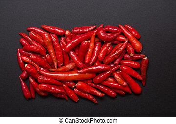 Heap of non-stem red bird eye chili pepper