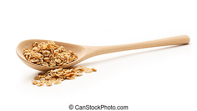 Heap of oat flakes with wooden spoon
