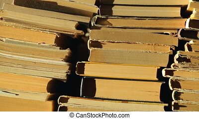 Heap of old books in sunlight
