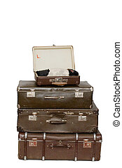 Heap of old suitcases isolated on white