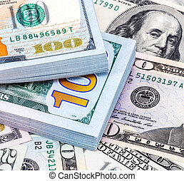 Heap of one hundred american dollar banknotes over money background, close up