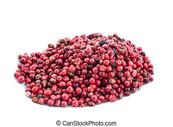heap of pink pepper in corns