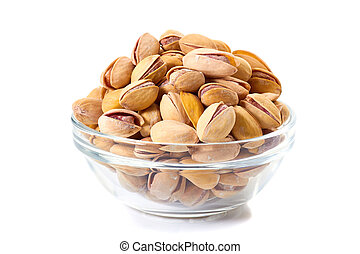 Heap of pistachios nuts in glass bowl