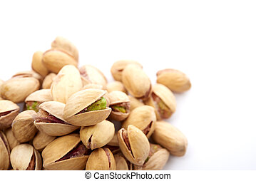 Heap of pistachios nuts isolated on the white